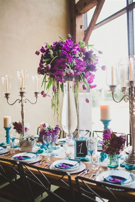 The head table will feature three crystal candelabras with