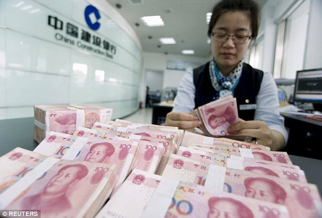 A clerk counts Chinese 100 yuan banknotes at a branch of China Construction Bank in Hai'an, Jiangsu province. China devalued its currency on Tuesday after poor run and announced another cut yesterday