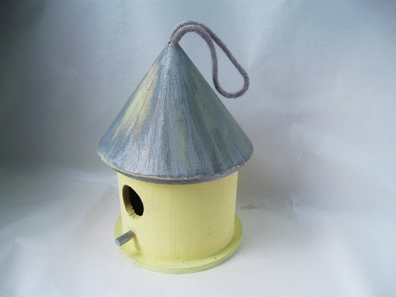 Rustic bird house, yellow and blue.  Feed the birds in style.