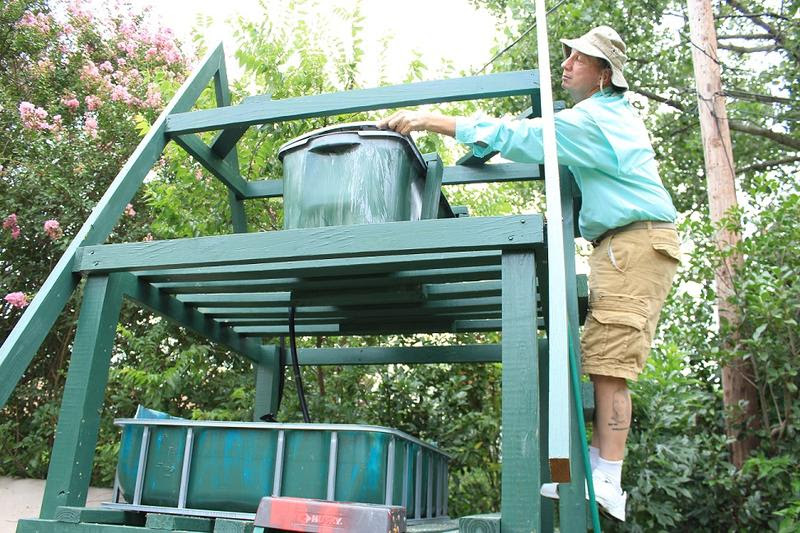 Dr. Michael Kemp and the top level of the aquaponics system.