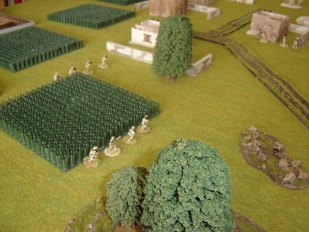 2nd Section enters village from flank