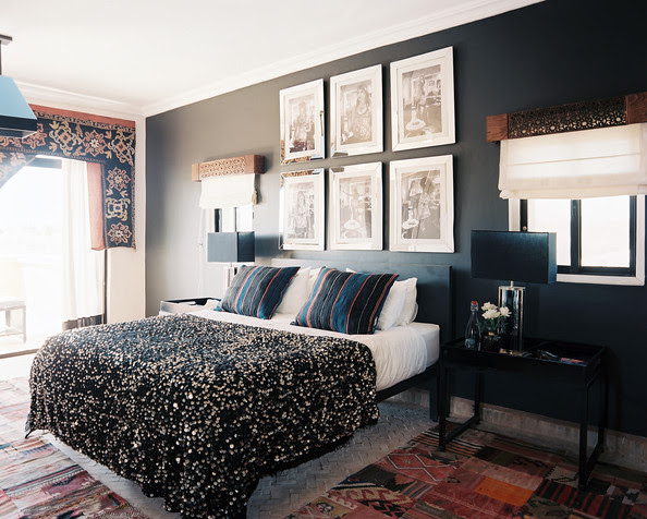 Bedroom - Black walls hung with black-and-white photography