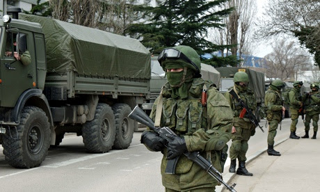 Armed Russian troops wait in convoy
