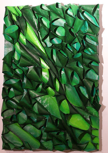 sculptural bas relief pod painting in various shades of green. Made of recycled cardboard tubes and acrylic paint.