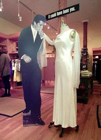 A mannequin wears a copy of the wedding dress worn by