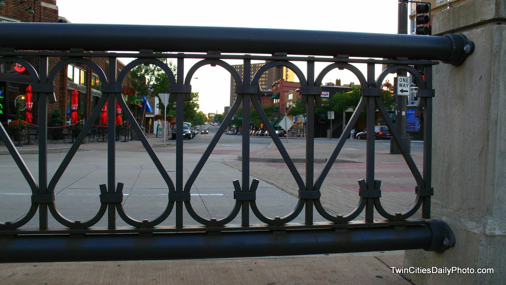 This decorative fencing, which separates the east bound traffic from the west gives a unique view of south bound 7th Street.