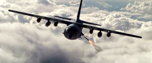 An AC-130 Spectre gunship fires its side cannons at Afghan insurgents attacking a village where Marcus Luttrell has taken refuge in LONE SURVIVOR.