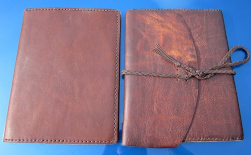 Two different leather notebook covers