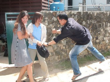 Michelle Smith's stabbing is reenacted outside the Katathani today