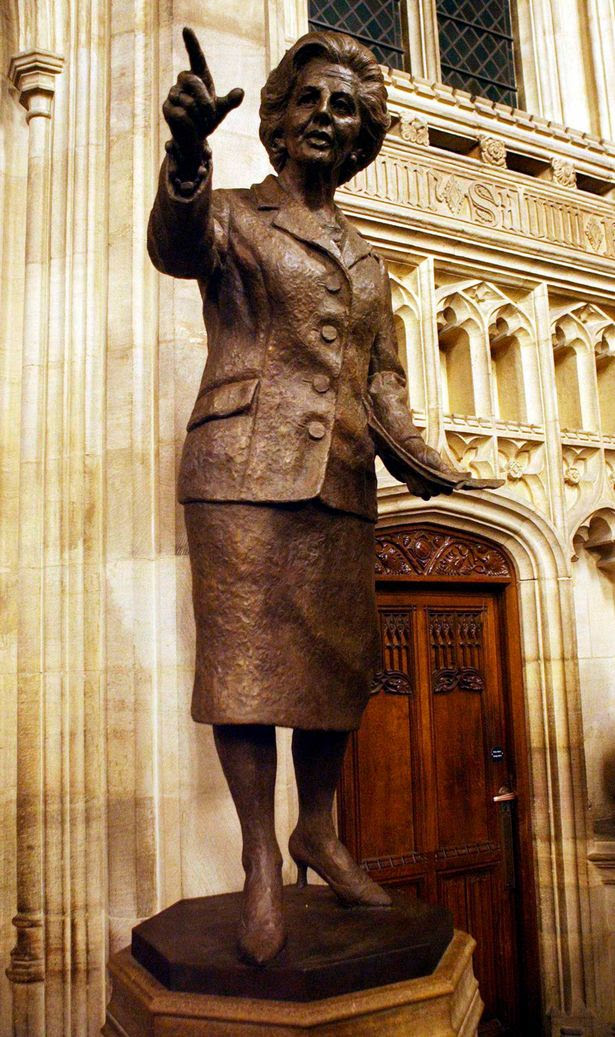 A bronze statue of former British PM Thatcher is seen inside the Palace of Westminster