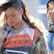 She wears it well: Rihanna rocks her shaved head and extensions as she prepares to jet out of New York