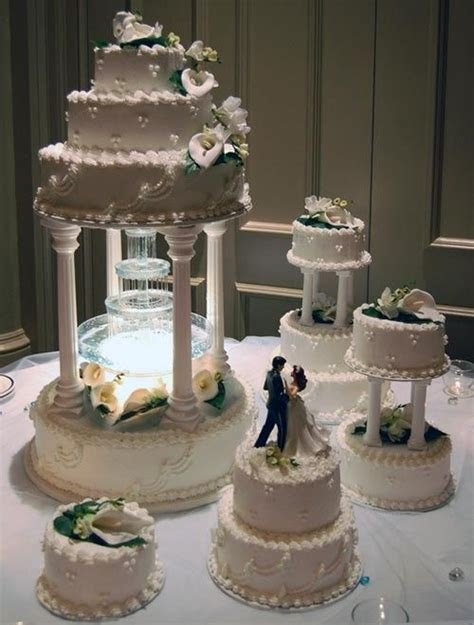 Four tier water fountain, butter cream wedding cake