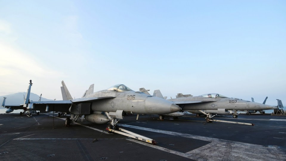 FILE PHOTO.  F/A-18 'Hornet' fighter jets are parked on the deck of the 'USS Carl Vinson' (CVN 70) aircraft carrier. EPA, STR
