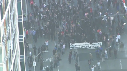 Anti-capitalist demonstrators clash with police in Seattle