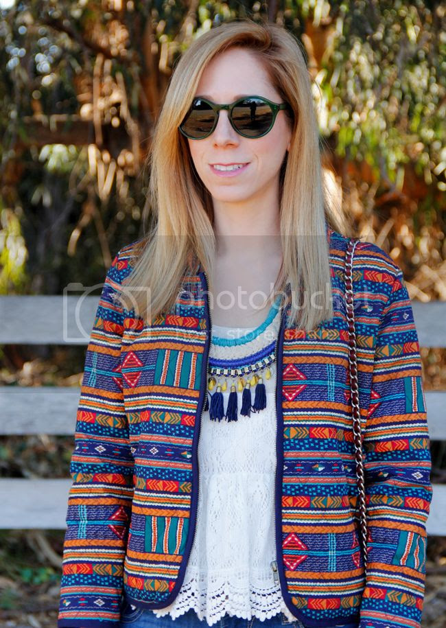 LA fashion blogger The Key To Chic wears a tassel necklace, quilted Forever 21 eclectic print jacket, peplum lace top, and Warby Parker Quimby Sunglasses in Absinthe