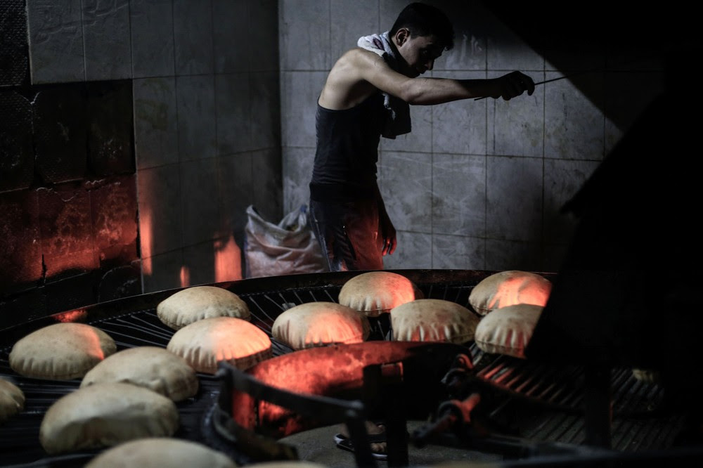 A Syrian man works at a bakery in the rebel-held town of Douma, east of the capital Damascus on June 19, 2016, as a part of an initiative to distribute bread to impoverished families in the Eastern Ghouta area during the holy fasting month of Ramadan. The bakery is managed by the Douma Society which was created in 1960. / AFP / Sameer Al-Doumy (Photo credit should read SAMEER AL-DOUMY/AFP/Getty Images)