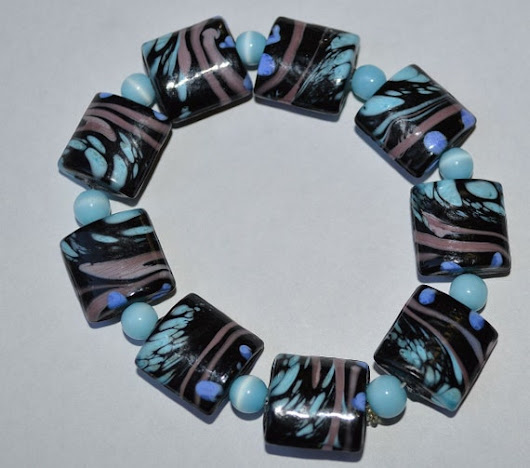 Beautiful Blue/Black Lampwork Stretch Bracelet with Turqoise Color Space Beads