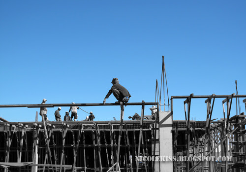 blue sky and workers