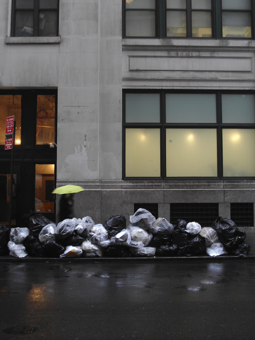 high pile of garbage on curb, 22nd Street, Manhattan, NYC