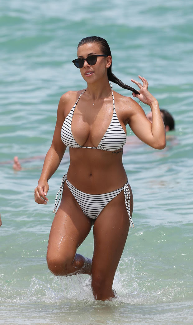 Devin Brugman flaunts her mind Bulging  in minuscule bikini as she hit the Miami beach.