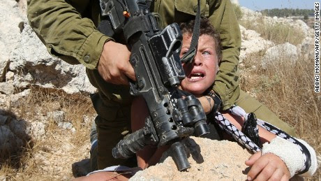 Images of Israeli soldier trying to arrest boy go viral - CNN.com
