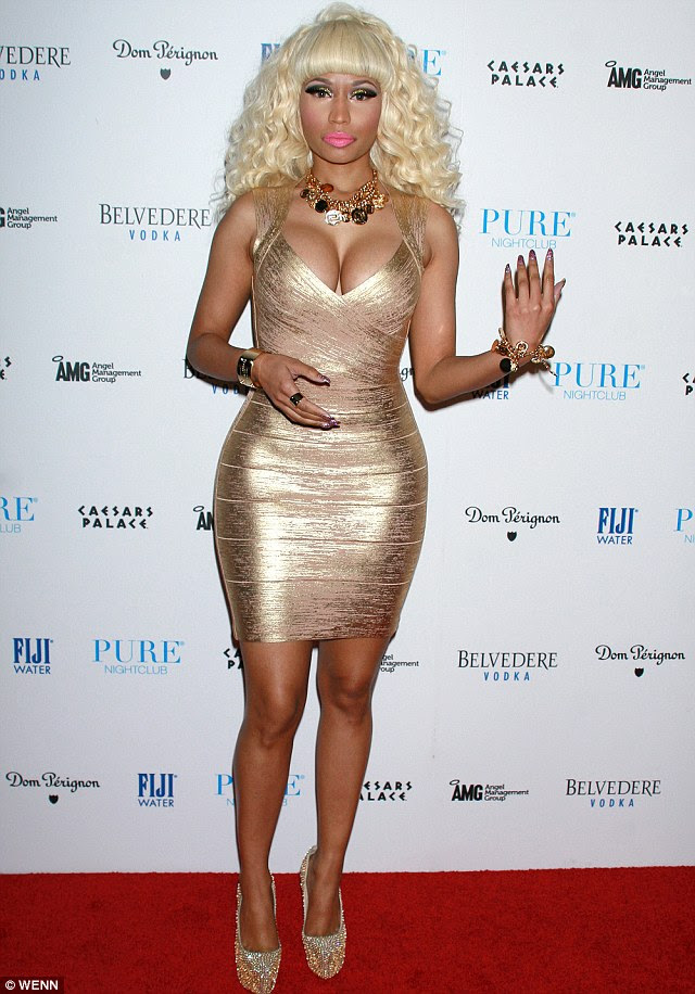 Sin City celebration: Nicki Minaj celebrated 2013 at Pure nightclub in Las Vegas, while Carmen Electra stepped out in clinging black at The Palazzo