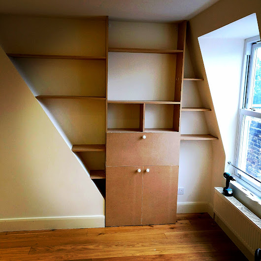 Bespoke Joinery Bookshelf fixing | A to Z Construct and Build Ltd Design and Build Company
