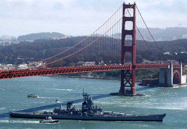 The USS Iowa passes underneath the Golden Gate Bridge as the battleship embarks on a final trip to SoCal, on May 26, 2012.