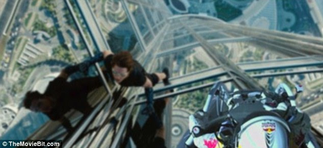 Head for heights: Tom Cruise climbs a tall building in Mission: Impossible - Ghost Protocol... but not THAT tall