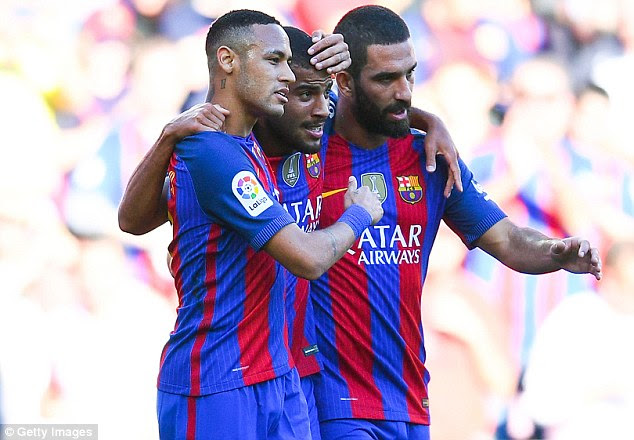 Rafinha (centre) is congratulated by Neymar (left) and Arda Turan after scoring his first