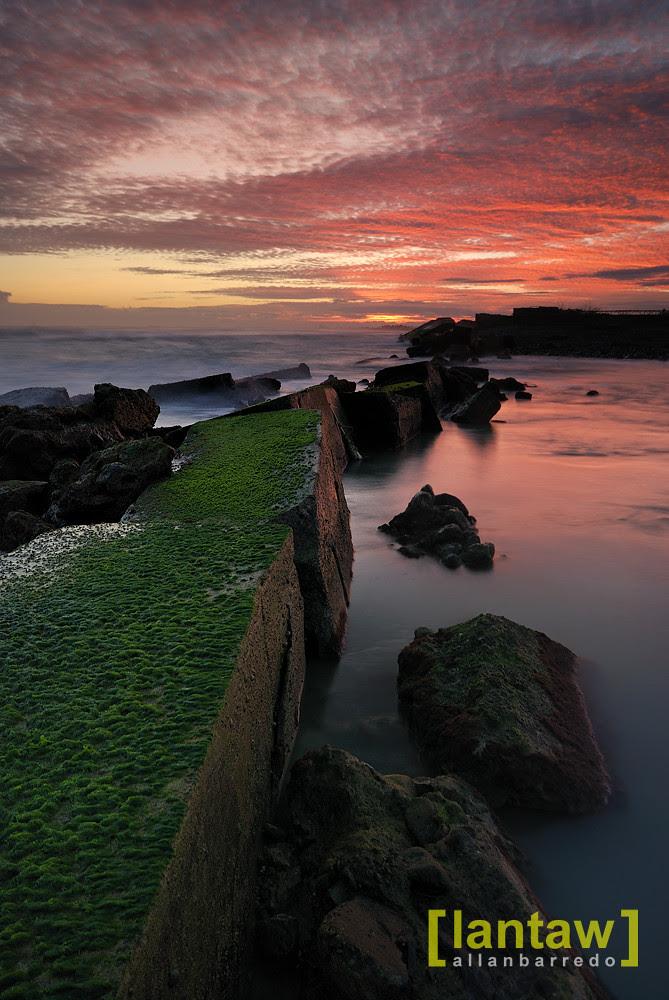 Sunrise by the broken seawall