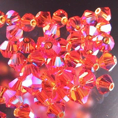 27753011519248 Swarovski Bead - 4 mm Faceted Bicone (5301) - Sun AB2 (36)