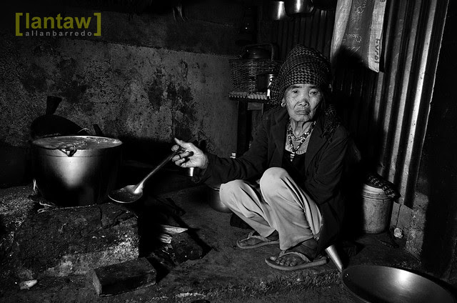 Whang-od cooking rice for dinner