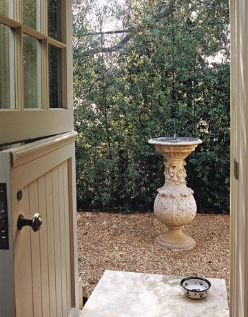 "A Dutch door painted in Farrow & Ball's French Gray leads to a sundial and the dog run. Christine Pittel, ""Kitchen of the Month,"" House Beautiful (June 2007). This classic English look was designed by Michael S. Smith. It was his Los Angeles house until recently."