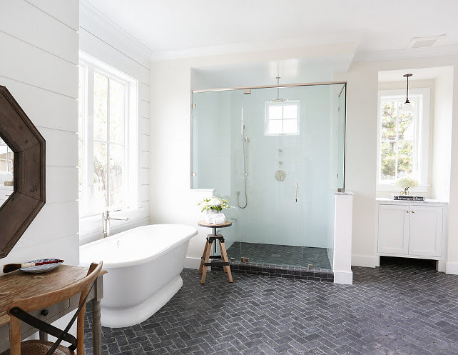 This bathroom is so appealing! I love the layout, the spacious shower with its own bench and the tongue and groove walls. The bathroom flooring is Blue Tumbled Limestone flooring set in a herringbone pattern.