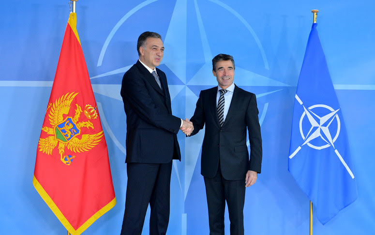Left to right:  President Filip Vujanovic of Montenegro shaking hands with NATO Secretary General Anders Fogh Rasmussen
