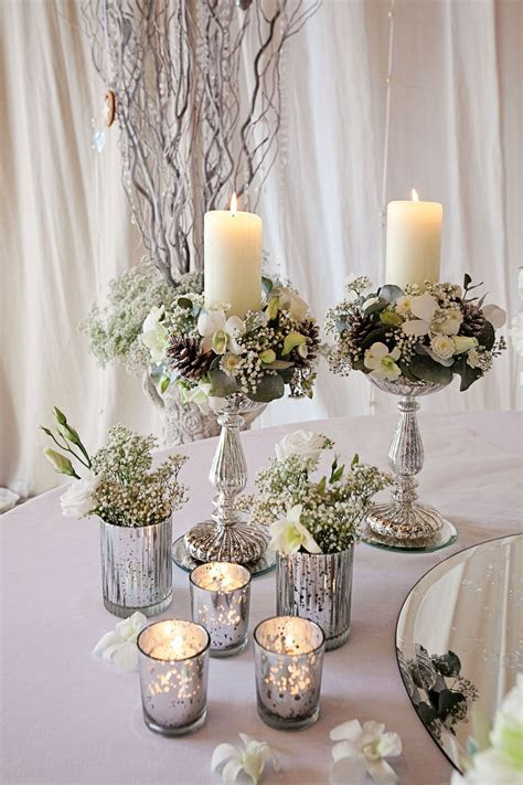 winter table flowers   silver mercury glass vases   Image