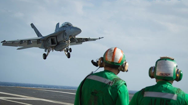 """ATLANTIC OCEAN (Jan. 13, 2018) -- An F/A-18F Super Hornet, assigned to the """"Black Lions"""" of Strike Fighter Squadron  (VFA) 213,  prepares to land on the flight deck of USS Gerald R. Ford (CVN 78). Ford is underway conducting test and evaluation operations. (U.S. Navy photo by Mass Communication Specialist 3rd Class Ryan Carter)"""