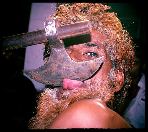 Axe Tongue Cutting by firoze shakir photographerno1