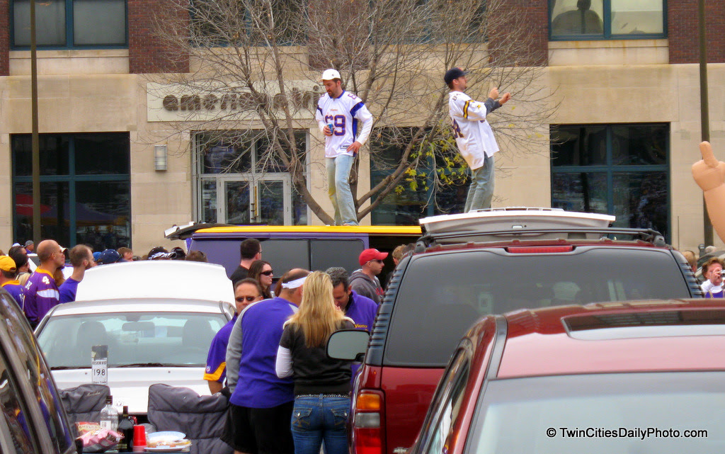 These two guys on top of the van, were up on the roof of the vehicle for nearly two hours while I was tailgating for the Vikings versus Cowboys football game. Whomever you two are, thank you for the photo opportunity. Go Vikes!