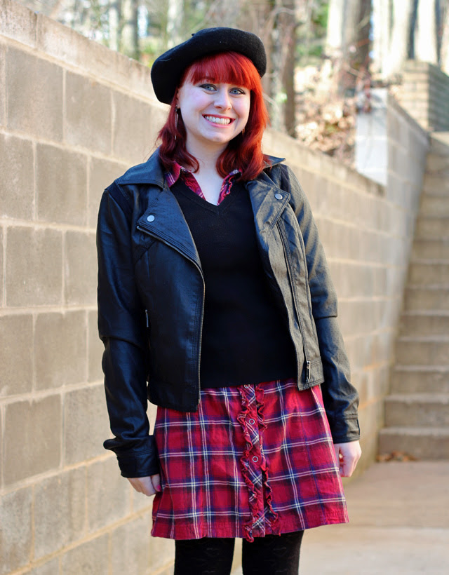 Black Beret, Black Leather Jacket, and a Sweater over a Plaid Dress