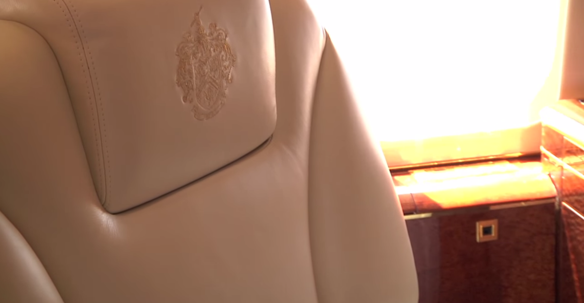 The plane's headrests and pillows are embroidered with the Trump family crest.