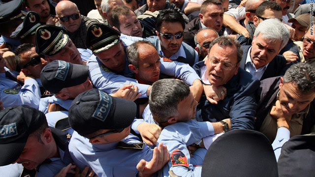 Opposition lawmakers attempt to push through a police line to get to the Central Election Commission in Tirana on Wednesday.