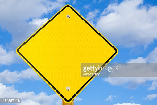 Blank Yellow Warning Or Yield Sign Stock Photo | Getty Images