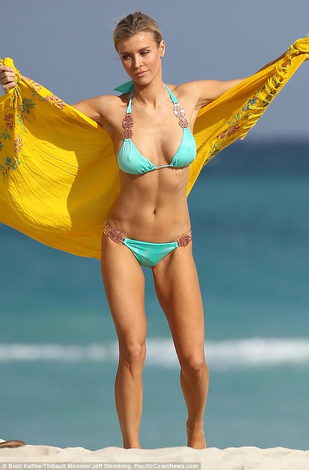 Beach break: Joanna looks stunning as dries off on the sands in Miami in her blue bikini