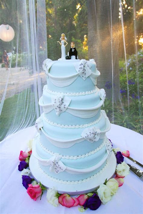 Beautiful light blue wedding cake with white frosting