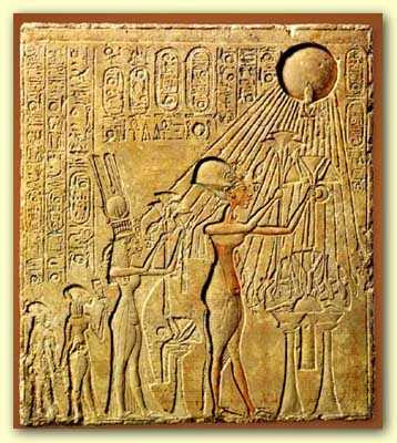 Pharaoh Akhenaten (center) and his family adoring the Aten, with characteristic rays seen emanating from the solar disk. The next figure leftmost is Meritaten, the daughter of Akhenaten, adorned in a double- feather crown.