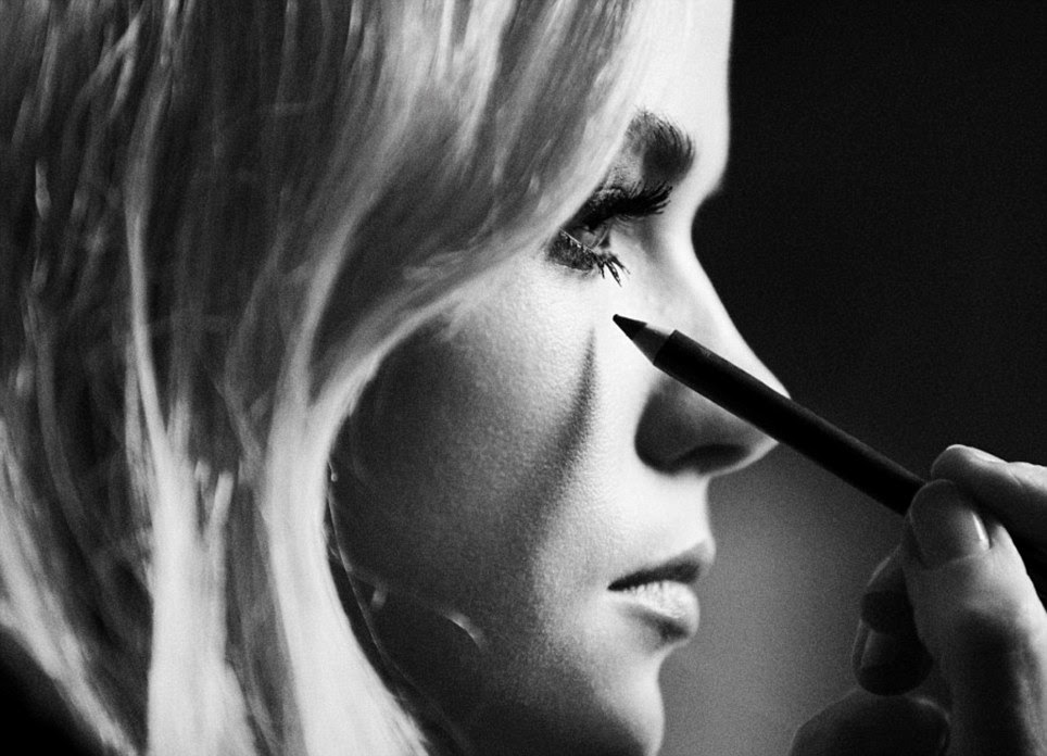 Ready for her close-up: Gabriella Wilde has her make-up applied in this behind the scenes shot from the Burberry autumn/winter campaign shoot