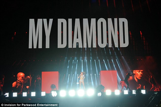 Rocking out: Beyonce took to the stage with 'My Diamond' emblazoned above her