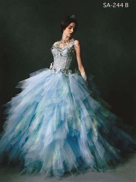 Light blue ball gown with glitter top and full ruffled